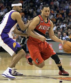 The Portland Trail Blazers' Brandon Roy, right, drives past the Phoenix Suns' Jared Dudley during the first quarter on Friday. The Trail Blazers won 101-94, beating the team that knocked them out of the playoffs last season.