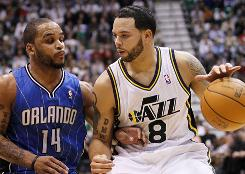 Utah Jazz point guard Deron Williams attempts to get past Orlando Magic point guard Jameer Nelson during the second half on Friday. Williams scored a season-high 32 points in Utah's 117-105 win.