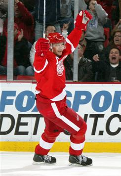 Nicklas Lidstrom celebrates his first-period goal against the Canadiens. Lidstrom and the Red Wings defeated Montreal 4-2.