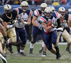 Navy fullback Alexander Teich breaks away for a gain against Army at Lincoln Financial Field in Philadelphia.