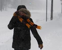Heavy snowstorms sweeping through the Midwest dumped over a foot of snow on the Minneapolis area Saturday.