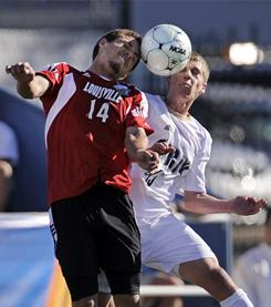 Louisville midfielder Nick DeLeon, left, and Akron midfielder Scott Caldwell head the ball during the first half of their NCAA championship soccer match on Sunday in Santa Barbara, Calif.