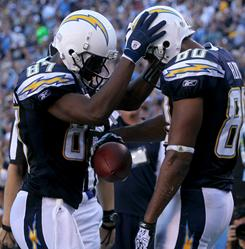 Malcom Floyd, right, Kelley Washington and the Chargers improved to 7-6 on Sunday.