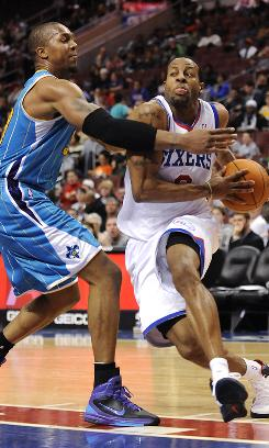 The 76ers' Andre Iguodala drives past the Hornets' David West in the second half on Sunday in Philadelphia. Iguodala had 16 points and 10 assists as the 76ers won 88-70.