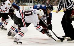 Blackhawks left wing Patrick Sharp faces off against Avalanche center Paul Stastny at the Pepsi Center in Denver on Monday night. The Avalanche defeated the Blackhawks 7-5.