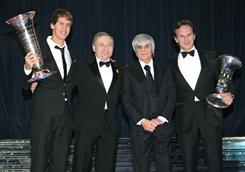 From left to right, Formula One champion Sebastian Vettel, FIA President Jean Todt, President and CEO of Formula One Management Bernie Ecclestone and Red Bull team manager Christian Horner pose together during a FIA gala in Monaco Dec. 10.