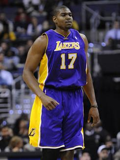 Lakers center Andrew Bynum had seven points, four rebounds and two blocks in his season debut Tuesday night.