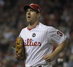 Cliff Lee, who was stung when the Phillies traded him last offseason, is rejoining them for less money than the Yankees and Rangers were offering.