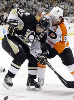 Philadelphia's Mike Richards, right, will get the task Tuesday night of trying to shut down red-hot Pittsburgh center Sidney Crosby.