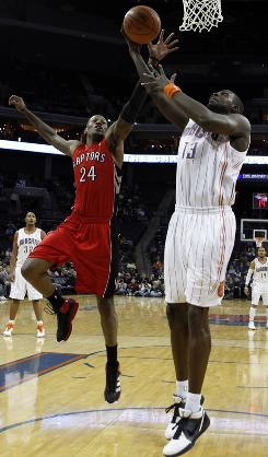 The Charlotte Bobcats' Nazr Mohammed shoots over the Toronto Raptors' Sonny Weems in the first half on Tuesday.