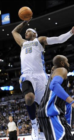 Denver Nuggets forward Carmelo Anthony goes up for a dunk against the Orlando Magic during the second half onTuesday.