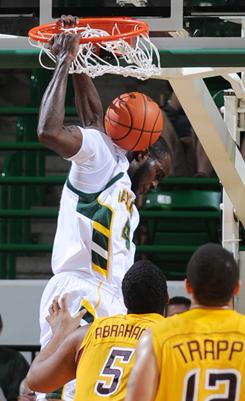 Baylor's Quincy Acy dunks over Bethune-Cookman's Albert Abrahams in the first half of Baylor's 83-39 win on Wednesday in Waco, Texas.