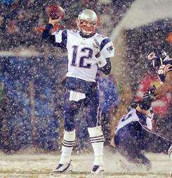 Tom Brady dodged snowflakes at Soldier Field to lead the Patriots past the Bears 36-7 last Sunday.