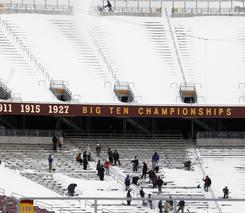 Workers clear the stadium at TCF Bank Field
