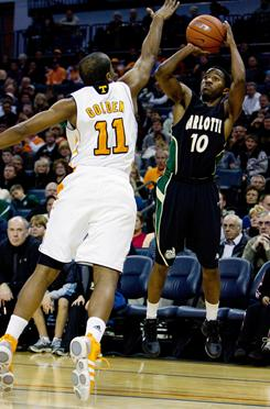 Charlotte 49ers guard Deuce Briscoe, right, scored 14 points in a 49-48 upset victory over No. 7 Tennessee.