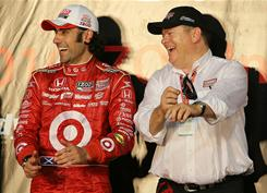 Ganassi Racing driver Dario Franchitti, left, celebrates after winning the IndyCar Championship with team owner Chip Ganassi on  Oct. 2 in Homestead, Fla. Ganassi Racing added Graham Rahal and Charlie Kimball to its IndyCar team.