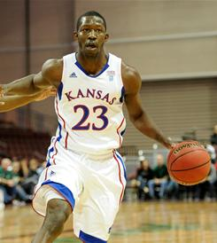 Kansas suspended Mario Little while he faces several criminal charges stemming from a fight.
