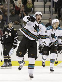 Sharks center Logan Couture celebrates his goal against the Stars in overtime as his teammates look on during the Sharks' 4-3 win on Thursday in Dallas.