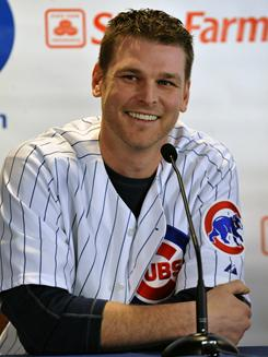 Kerry Wood won the 1998 NL Rookie of the Year award with the Chicago Cubs. Friday he returned to the Cubs on a one-year contract.