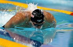 Three-time Olympic U.S. gold medalist Ryan Lochte sets a new world record of 1:50.08 in the men's 200-meter individual medley at the FINA world short-course swimming championships in Dubai on Friday.