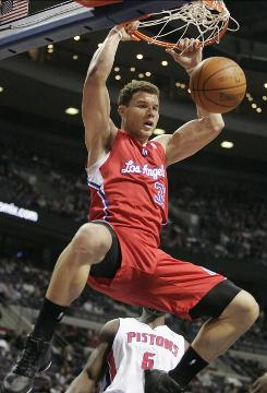 The Los Angeles Clippers' Blake Griffin dunks against the Detroit Pistons in the first half on Friday. Griffin scored his 14th consecutive double-double and the Clippers won109-88.