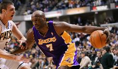 Los Angeles Lakers power forward Lamar Odom drives to the basket against Indiana Pacers forward Tyler Hansbrough on Friday. Los Angeles defeated Indiana 109-94.