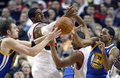 The Golden State Warriors' David Lee, left, goes for the loose ball with Portland Trail Blazers' LaMarcus Aldridge, second from left, and teammate Andre Miller and Warriors' Rodney Carney (25) in the second quarter on Saturday.