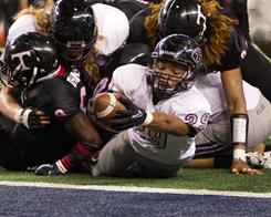Pearland running back Dustin Garrison (29) stretches for one of his three touchdowns against Trinity in the Class 5A-I state title game. Garrison had 121 yards rushing and Pearland defeated Trinity 28-24.