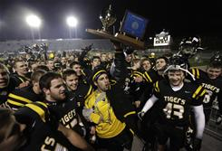 North Allegheny players celebrate their 21-0 victory over LaSalle in the Pennsylvania Class 4A state championship game.