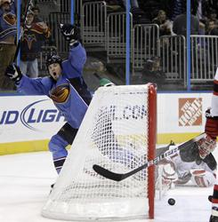 Atlanta Thrashers left wing Eric Boulton celebrates after scoring his third goal in a 7-1 win over the New Jersey Devils in Atlanta.