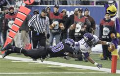 Wisconsin-Whitewater running back Levell Coppage dives into the end zone for one of his three touchdowns during a win over Mount Union in the Div. III championship in Salem, Va.