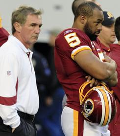 Coach Mike Shanahan, left, and quarterback Donovan McNabb stand on the sideline before the Redskins' game against the Dallas Cowboys on Sunday in Arlington, Texas.