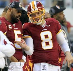 Donovan McNabb, left, and Rex Grossman during Sunday's loss in Dallas.
