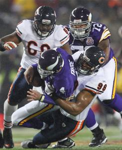 Chicago Bears defensive end Corey Wootton sacks Minnesota Vikings quarterback Brett Favre during the first half. Favre was injured on the play and would not return.