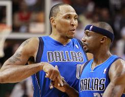 The Mavericks' Shawn Marion, left, congratulates Jason Terry after the latter scored against the Heat in the fourth quarter on Monday. The Mavericks won 98-96 and snapped Miami's 12-game winning streak.