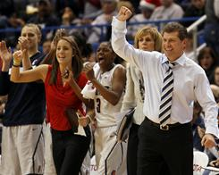 Connecticut women's basketball coach Geno Auriemma, right, watched the Huskies beat Florida State for the program's 89th consecutive victory.