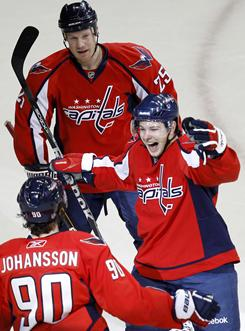 Capitals forward Andrew Gordon, right, celebrates with teammates Marcus Johansson and Jason Chimera after scoring a goal against the Devils in Washington. The Capitals won 5-1.