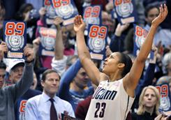 Connecticut forward Maya Moore celebrates near the end of the Huskies' NCAA record-breaking 89th consecutive victory.