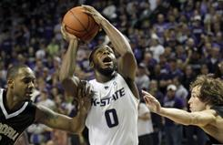 Kansas State's Jacob Pullen, here shooting during a game against Emporia State on Nov. 29, and teammate Curtis Kelly were suspended for receiving impermissible benefits.