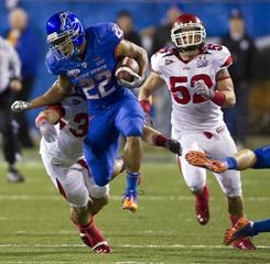 Boise State running back Doug Martin breaks through the Utah defense during the the first half of the Maaco Bowl. Boise State won 26-3.