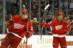 Red Wings center Valtteri Filppula, left, and right wing Todd Bertuzzi celebrate Filppula's second-period goal against the Canucks.