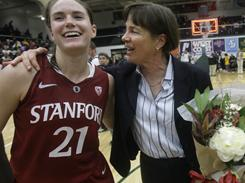 Stanford coach Tara VanDerveer, right, celebrates with guard Sara James after Stanford beat San Francisco 100-45 for VanDerveer's 800th career victory.