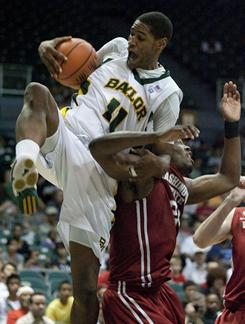 Baylor's J'mison Morgan, left, grabs a rebound and is fouled by Washington State forward DeAngelo Casto, right, in the first half of Washington State's 77-71 upset win at the Diamond Head Classic in Honolulu on Thursday.