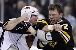 The Bruins' Shawn Thornton, right, fighting with the Thrashers' Eric Boulton in the first period, scored twice to lead Boston to a 4-1 win.