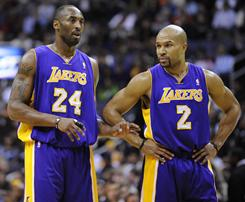 Kobe Bryant (left), Derek Fisher and the Lakers will play LeBron James and the Heat on Christmas Day in an NBA matchup that is generating buzz  and talk of a preview of a possible Finals matchup.