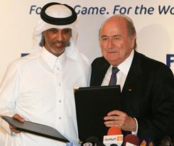 """We go to new lands."" With that proclamation, FIFA president Sepp Blatter, right, and soccer's world governing body awarded the 2022 World Cup to Qatar. Blatter poses with Sheikh Hamad bin Khalifa bin Ahmed al-Thani, president of the Qatar Football Association ."