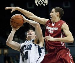 Butler center Andrew Smith, left, is fouled by Washington State guard Klay Thompson while attempting a shot in the first half. Smith scored 14 points to help the Bulldogs win the Diamond Head Classic.