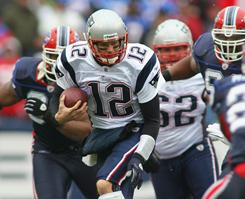 Tom Brady and the Patriots clinched the AFC's No. 1 overall seed on Sunday.