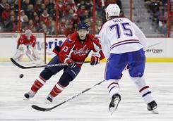 Capitals center Jay Beagle (83), flipping the puck past Montreal Canadiens defenseman Hal Gill, opened the scoring for Washington in the first period.