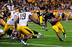 Iowa running back Marcus Coker runs during the second quarter against the Missouri Tigers during the Insight Bowl at Sun Devil Stadium in Tempe, Ariz., on Tuesday. Suspensions gave Coker his opportunity to play and he didn't disappoint in Iowa's 27-24 win over Missouri.